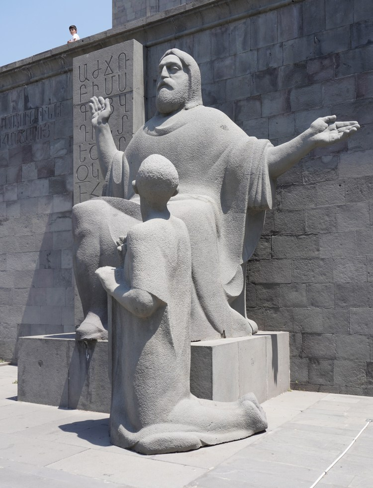 A statue of Mesrop Mashtots, inventor of the Armenian alphabet, outside the Matenadaran in Yerevan, Armenia.