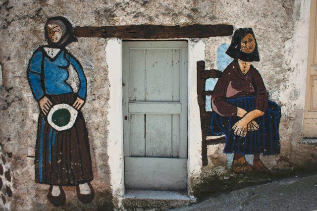 Mural of old ladies in Orsogolo Sardinia