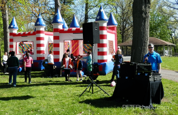 My set-up next to the bounce houses, which were a big hit with the kids all day.