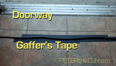 Gaffers tape is always used when cables have to run across doorways, like this emergency exit. Gaffer's tape is especially made for this purpose, and can be removed from the floor without leaving the messy goo duct tape is known for.