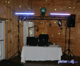 Indoor DJ setup (sound and lights) at Kimberly and Giovanni's wedding at Wolf Oak Acres in Oneida, NY, June 2018