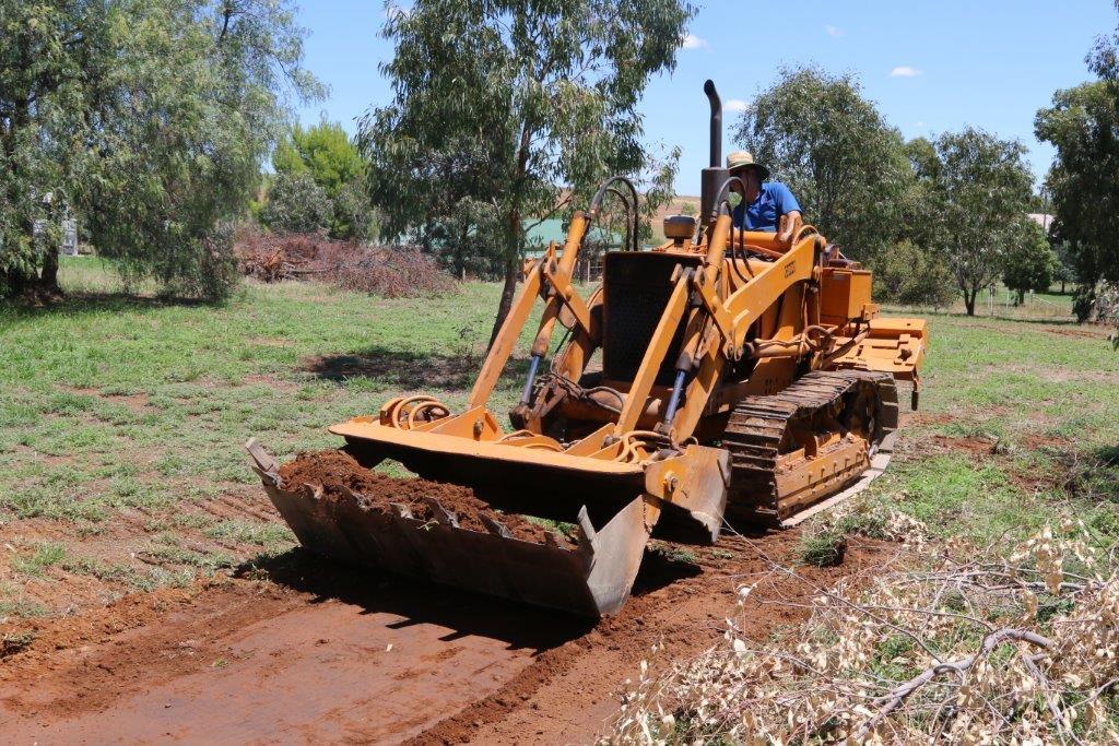 Scraping Surface Soil