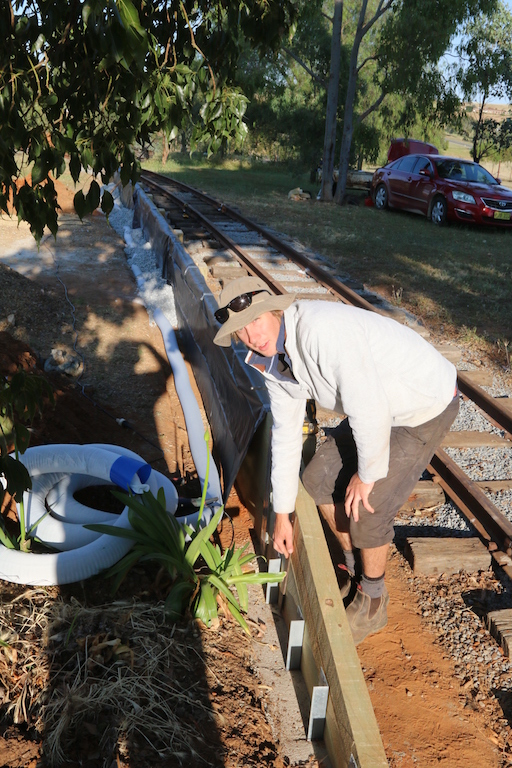 Image 2016.4969: Josh shows how the sloping ends to the platform are secured with metal uprights. (Tuesday, 29th November 2016)