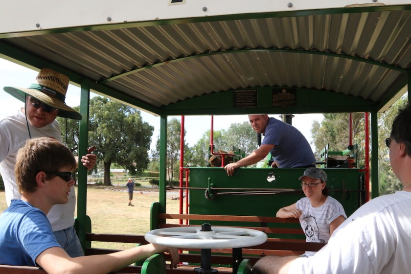 """Image 2016.5042: With most of the volunteer workforce on board and XPT driver Dave at the throttle, the Hunslet powers upgrade over the regraded track. In the carriage are Ben, Rhys, """"Kat"""" and Nicholas; while in the distance, platform-builder Josh is taking his own photo. (Photo: Peter Neve, Thursday, 1st December)."""