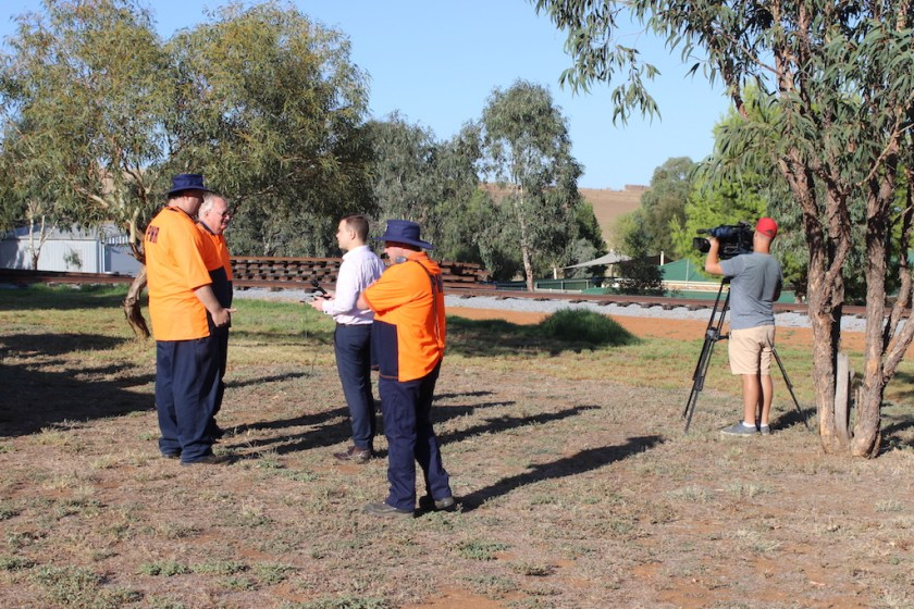 Peter and Nicholas talking to Chris Meldrum, with Ben in the foreground and Dan, Prime 7's cameraman