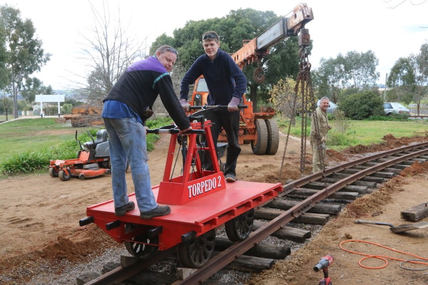 "Image 2017-3212: Chocks prevent ""Torpedo 2"" from running back down the grade as Ben and Rhys pose on the new level crossing."