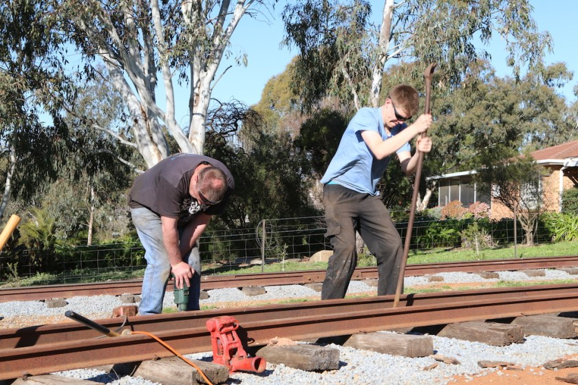 Image 2017.4098: It was necessary to carry out further works to Mario's recent track extension before it could be used. Here, Ben and Rhys insert additional sleepers later that day… Note Rhys' facial expression!