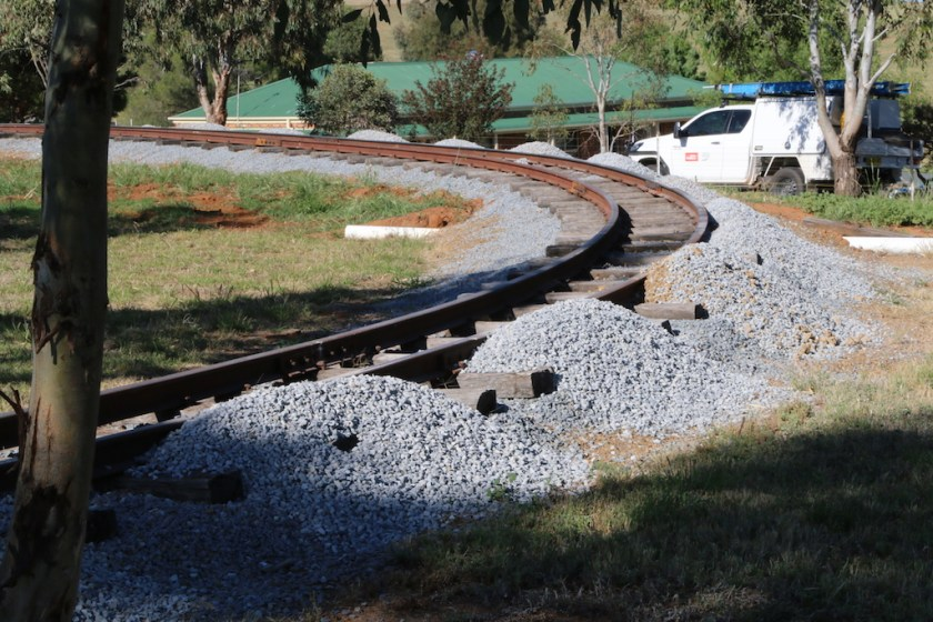 """Image 2017.4966: Heaps of ballast, ready for the track gang to """"lift, super-elevate and pack""""."""