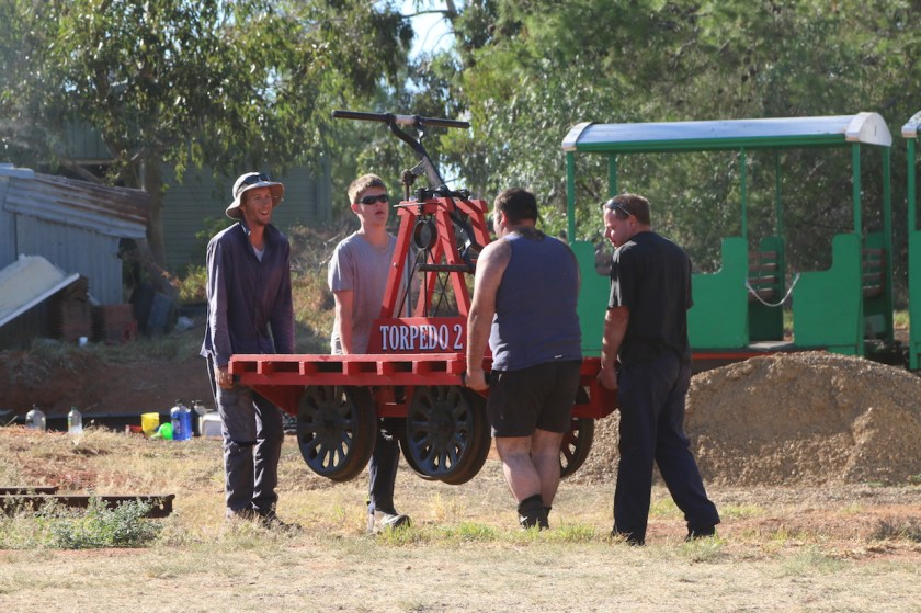Image 2018.0365: Friday 10/03/2018 - Josh, Rhys, Matt and Ben manhandle Torpedo 2 from its rail resting place to be loaded on to the car trailer for the Festival Parade on the following day.