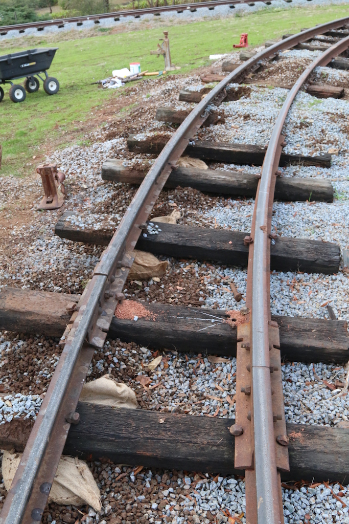 Image 2018.1473: Part of the main line required super-elevation adjustments. A trick-of-the-trade was to partially fill sand-bags with ballast and place them under the sleepers under the rail in order to maintain the elevation required, Additional ballast would then be packed under, but not over, the remainder of the sleepers as required.
