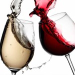 Image of red and white wine spilling