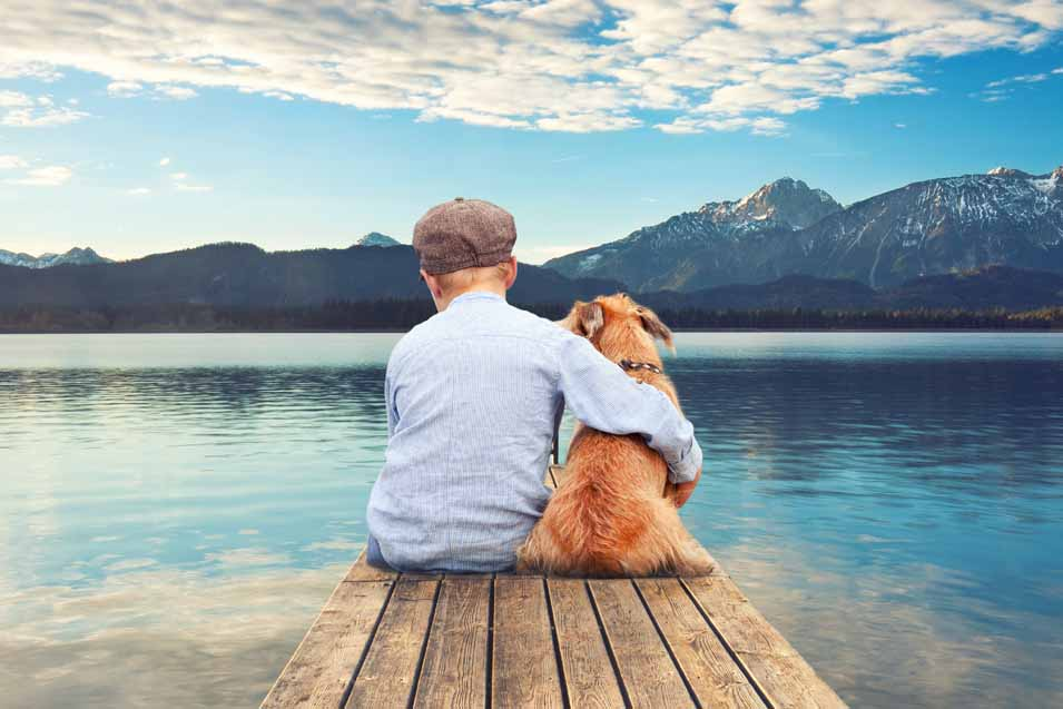 Picture of a boy and dog at the lake