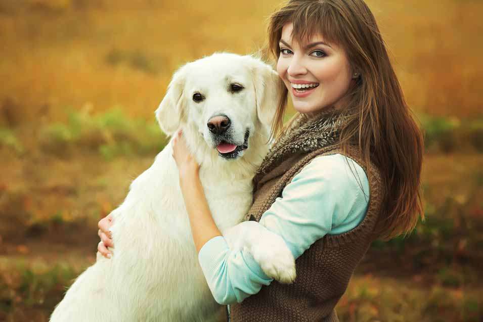Picture of a white dog and its owner