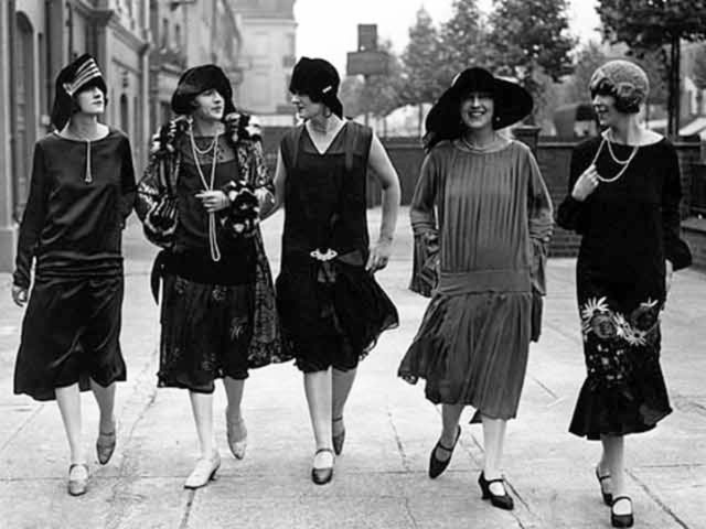 Women from the 1920s wearing fashions of that era.