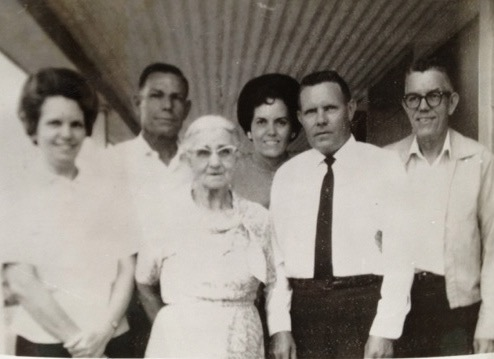 An old black and white photo of my great-grandmother and her adult children.