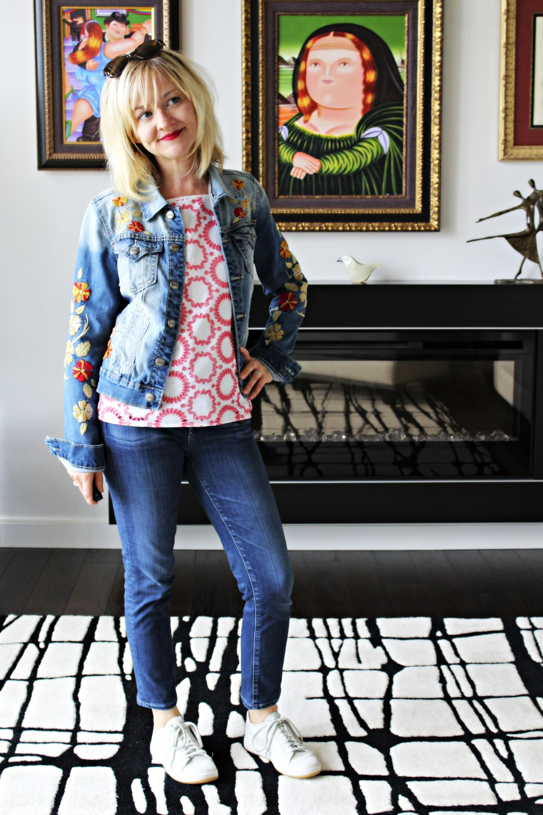 embroidered denim jacket with cotton cami and cropped jeans and white sneakers