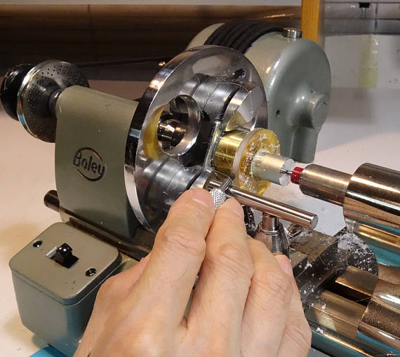 watchmaker's lathe creating stainless steel clasps for monocle magnifying necklace