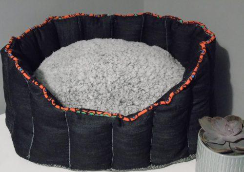 Denim dog bed with coloured trim and grey teddy cushion