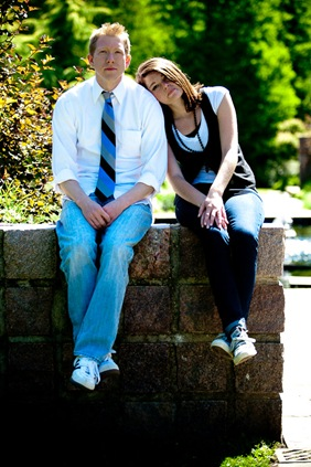 man and woman sitting on wall  at Brookside Gardens in Wheaton MD