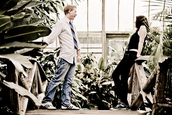man and woman standing on foot bridge in conservatory at Brookside Gardens in Wheaton MD