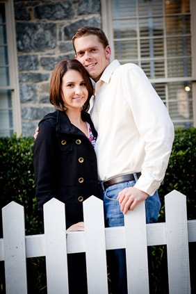 man and woman in Ellicott City in front of white picket fence