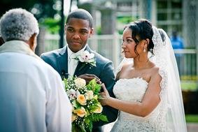 bride and groom at alter  at the Newton White Mansion in Mitchellville MD