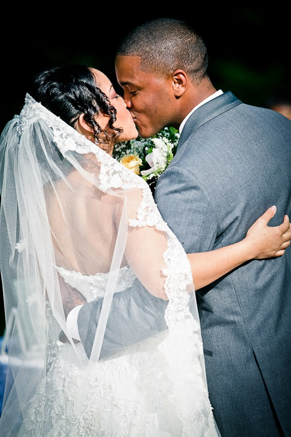 bride and groom kissing  at the Newton White Mansion in Mitchellville MD