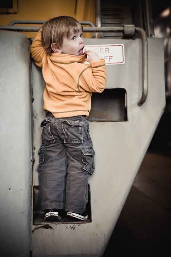 boy climbing on locomotive at Baltimore & Ohio Railroad Museum