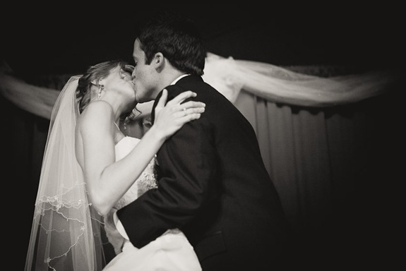Bride and groom first kiss during ceremony in Mechanicsville MD