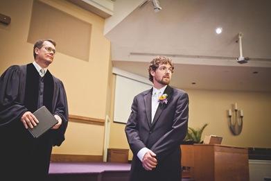 groom watching bride walk down isle at Annapolis EP
