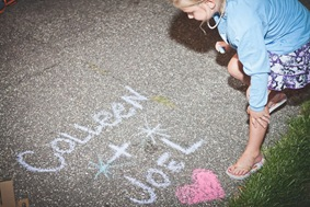 bride and groom's name written in chalk on the ground