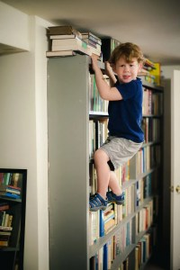 kid-climbing-bookcase