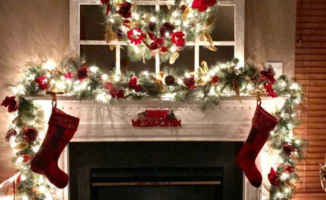 Elegant And Festive Christmas Wreath And Garland At Night