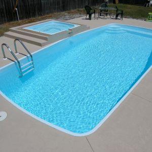 Arena 12' x 27' Pettit Fiberglass Pool with overflow spa