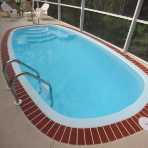 Fiesta 10' x 20' Pettit Fiberglass Pool with brick decking