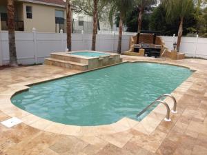 Roman 13' x 30' Pettit Fiberglass Pool with overflow spa