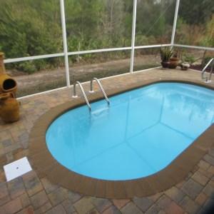 Splash 8' x 16' Pettit Fiberglass Pool with pavers
