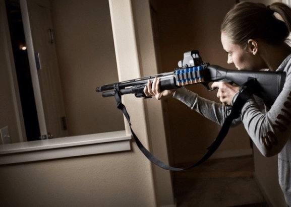 Woman defending home with shotgun