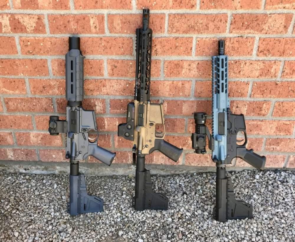 medium resolution of three ar pistols