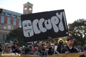 From Occupy to Wikileaks, the anarchist spirit of leaderless resistance, decentralized decision-making and autonomous self-governance, is rising. Photo: Tess Scheflan/Activestills.org