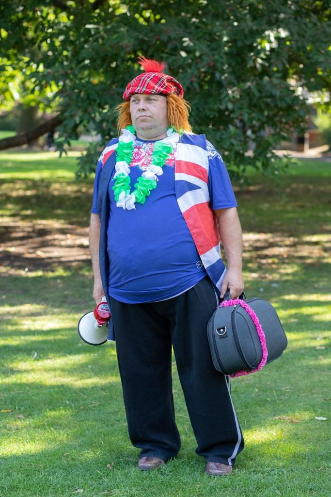 Dean Sainsbury dressed in Union Jack flag and Tarten hat.