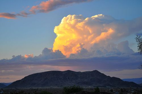 Photo by Jessie Eastland -  In the Mojave Desert, a Towering Vertical cloud appears to be set in place by a hand of the Gods.