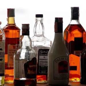 Alcohol bottles on bar counter