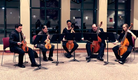 Phillip Serna directing the Music Institute of Chicago's Advanced Viol Consort before an Illinois Philharmonic Concert in Palos Hills, IL