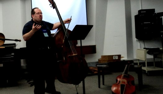 Phillip Serna presenting Making Your Baroque Solos More H.I.P. at the Historically Informed Performance Summit at the 2013 International Society of Bassists Convention at the Eastman School of Music in Rochester, NY.