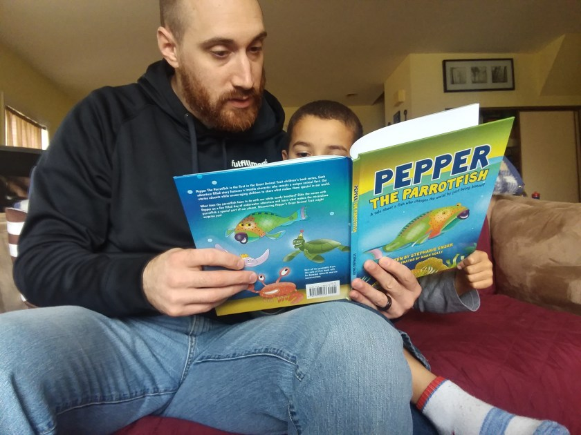 Husband Reading Pepper the Parrotfish - Philly Coupon Mom