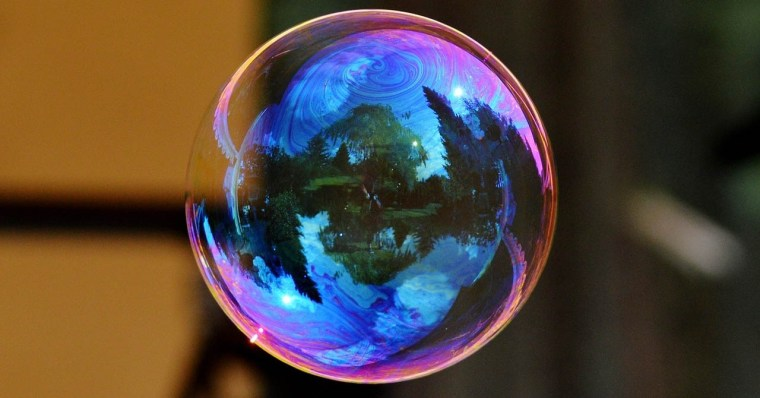 Photo of a large, colorful soap bubble. Creative Commons license, Pixbay.
