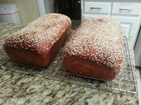 Loaves of honey whole-wheat sesame bread.