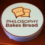 Photo of a sticker featuring the Philosophy Bakes Bread logo.