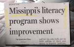 """Photo of a news article in which the headline about a literacy program in Mississippi misspells the state's name as """"Missippi."""""""